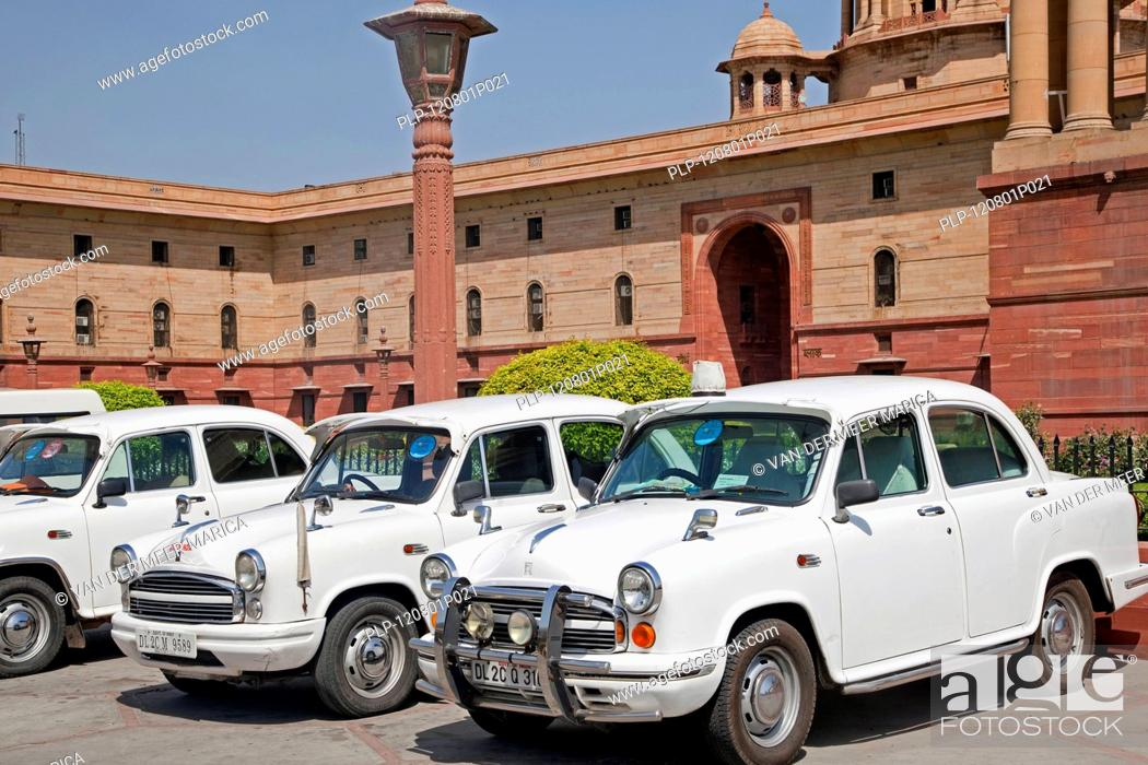 Stock Photo: Traditional old fashioned white Indian cars at Rashtrapati Bhavan, official residence of the President of India in New Delhi.