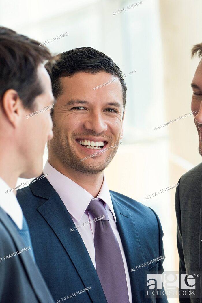Stock Photo: Businessmen having friendly conversation.