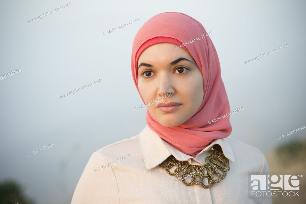Stock Photo: Beautiful Muslim woman looking away outdoors.