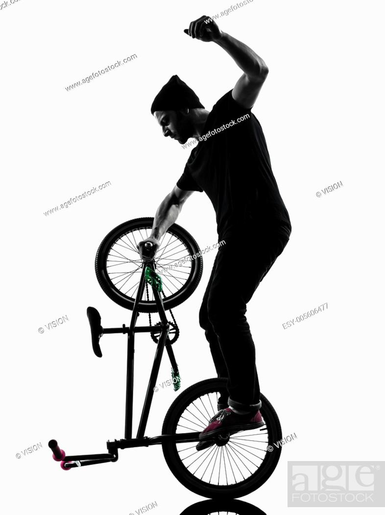 Stock Photo: one caucasian man exercising bmx acrobatic figure in silhouette studio isolated on white background.