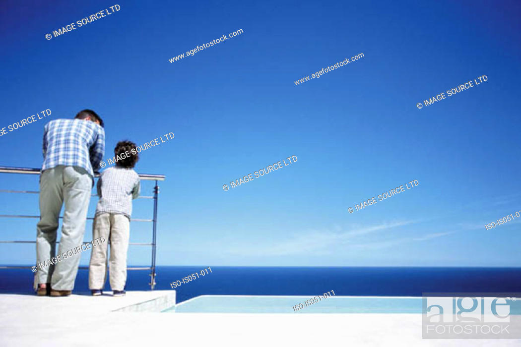 Stock Photo: Father and son enjoying a view of the sea.