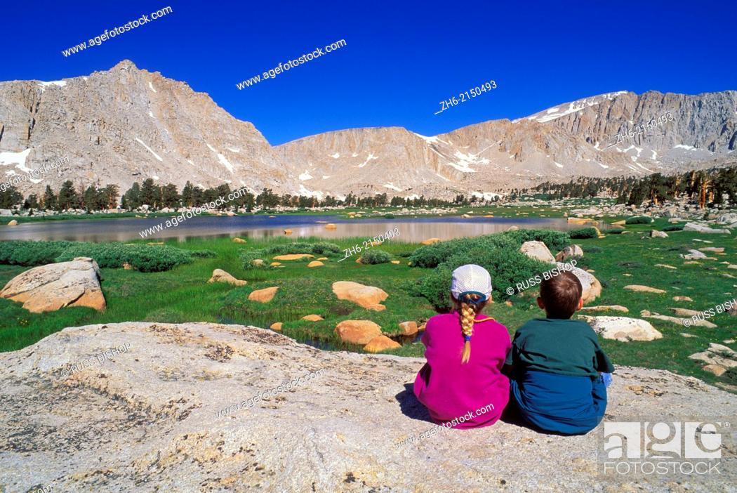 Stock Photo: Kids enjoying the view in the Cottonwood Lakes Basin, John Muir Wilderness, Sierra Nevada Mountains, California USA.
