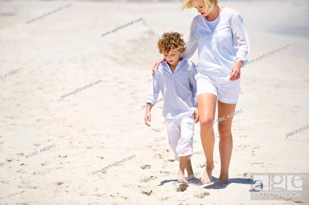 Stock Photo: Woman walking with her son on the beach.
