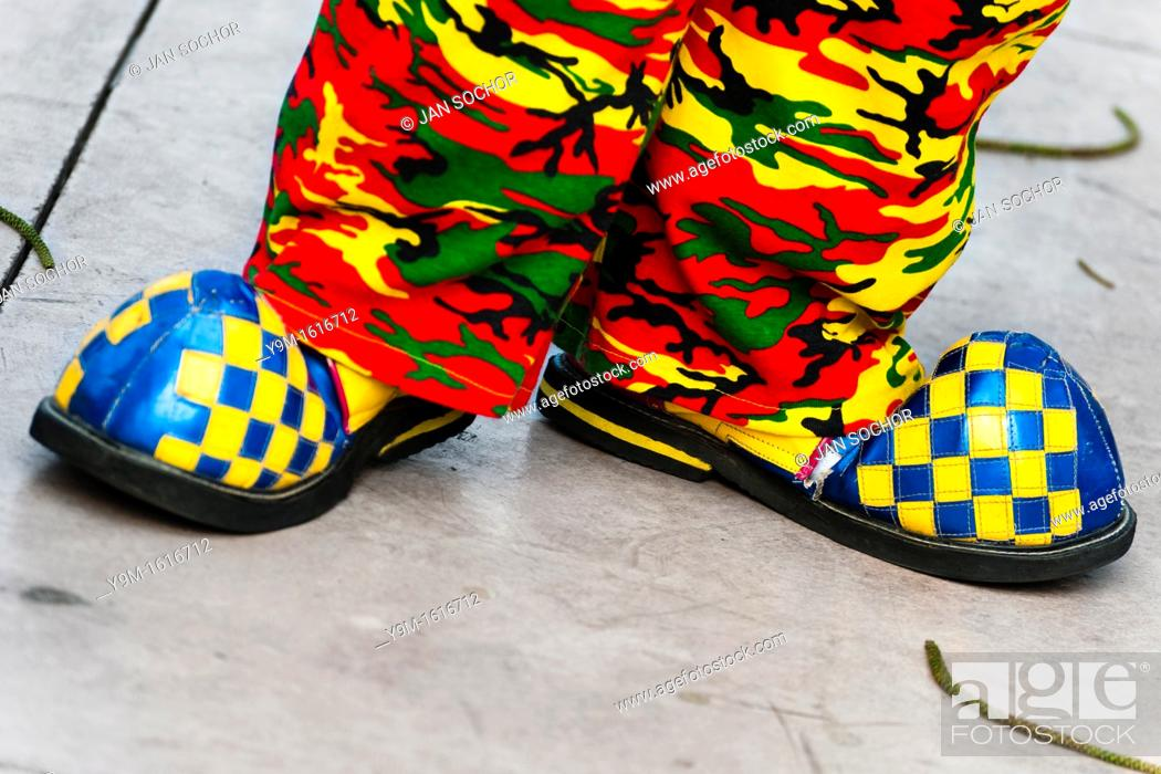 Stock Photo: A clown wears oversized blue and yellow shoes and colorful camouflage pants during the Clown Congress in San Salvador, El Salvador.