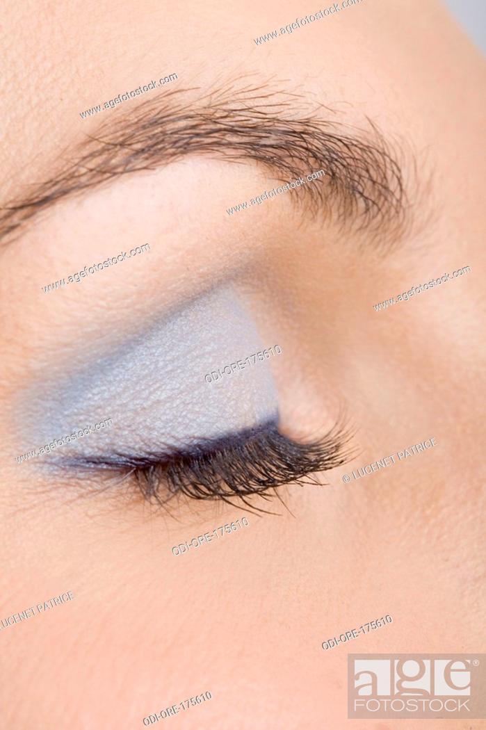 Stock Photo: Woman blue make-up.