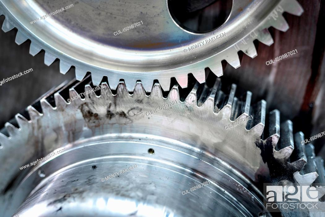 Stock Photo: Close up detail of driver wheels with cogs of locomotive engine in train works.