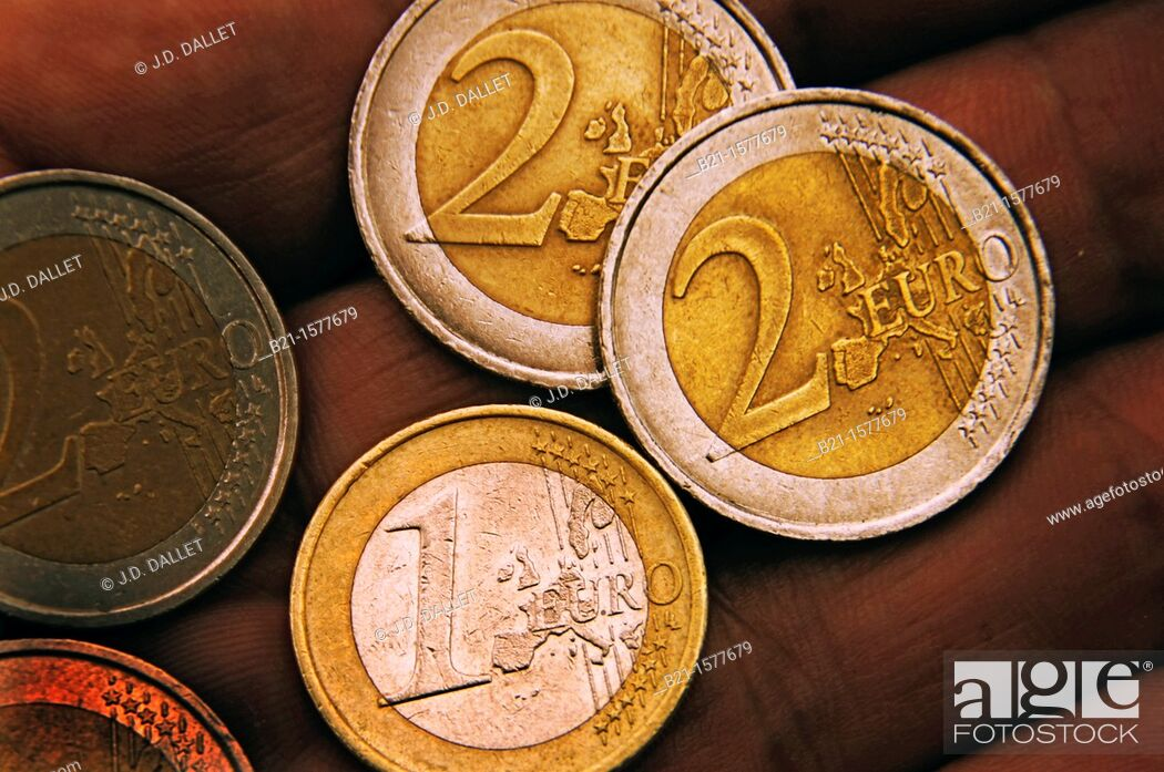 Stock Photo: One and two euro coins.