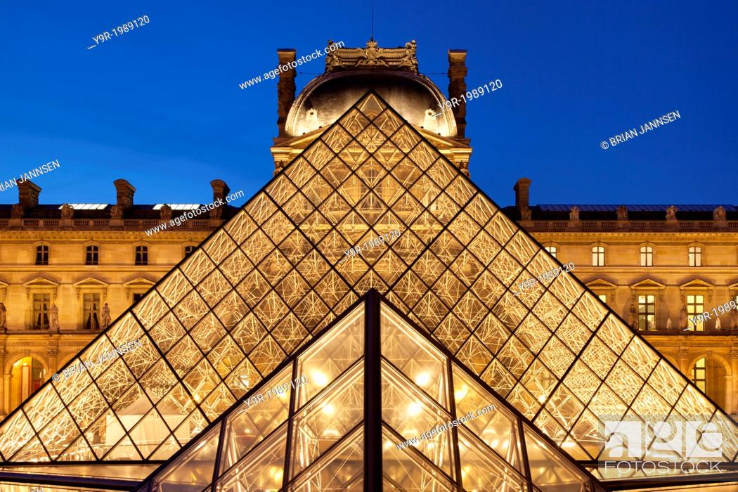 Stock Photo: Glass pyramid and ancient architecture of Musee du Louvre, Paris France.