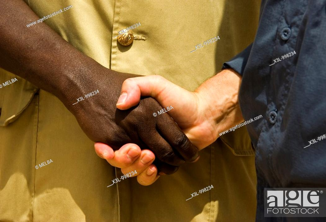 Stock Photo: Two men shake hands.