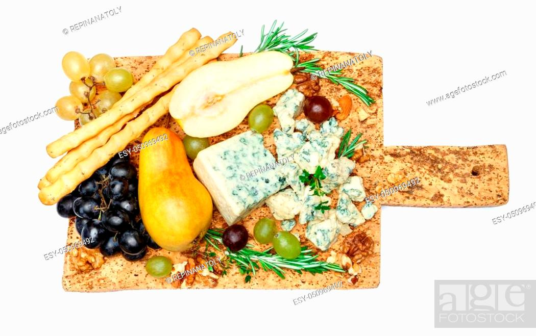 Stock Photo: pears and cheese on cork wooden cutting board.