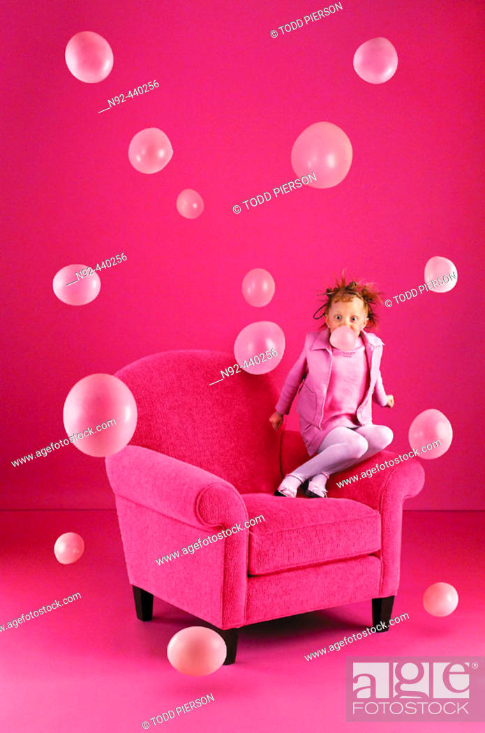 Stock Photo: 6 year old girl blowing bubbles.