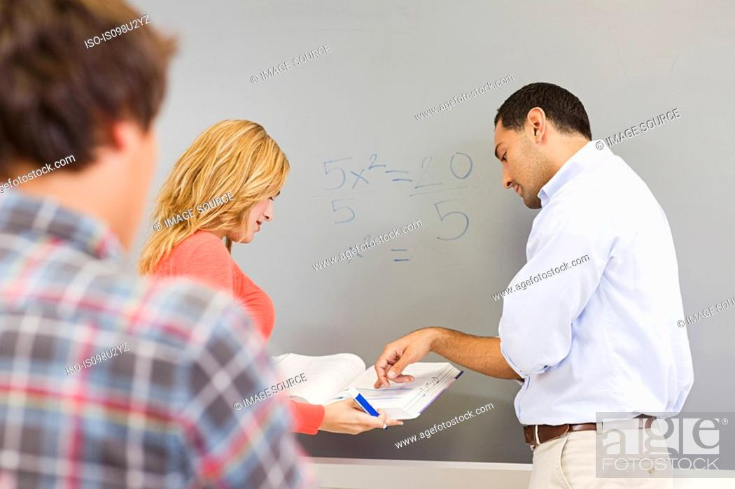 Stock Photo: High school students and teacher in classroom.