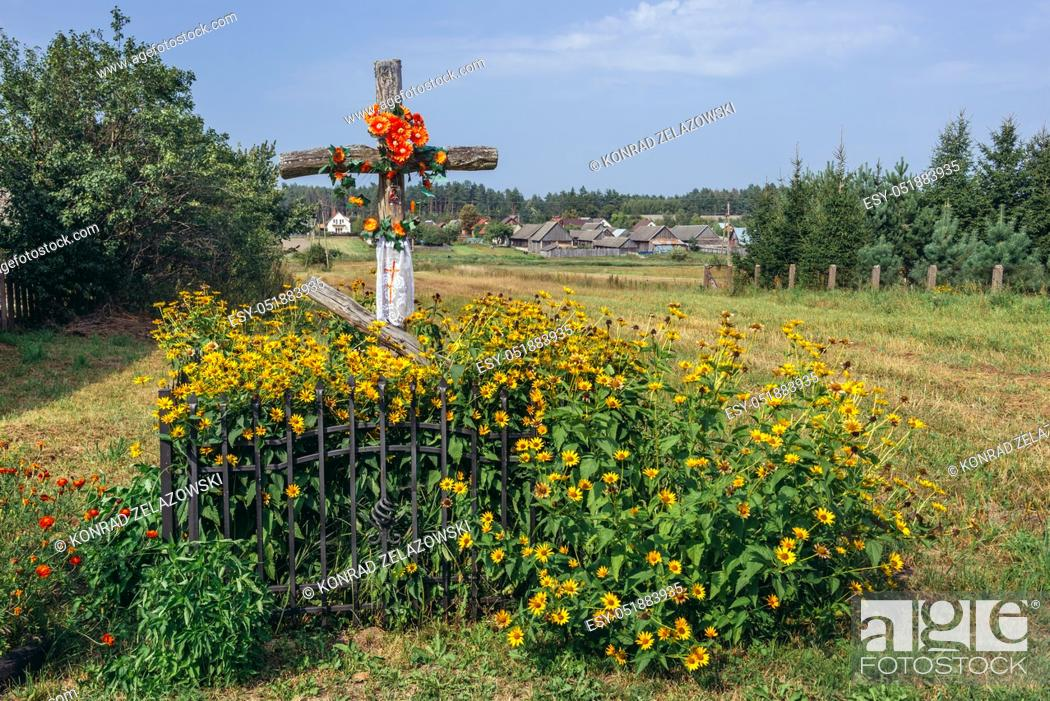 Stock Photo: Old wayside cross in Soce village on so called The Land of Open Shutters trail, famous for traditional architecture in Podlaskie Voivodeship, Poland.