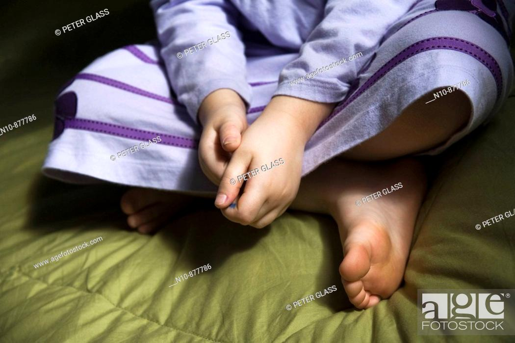 Stock Photo: Close-up of a young girl on her bed.  Model and Property Released.