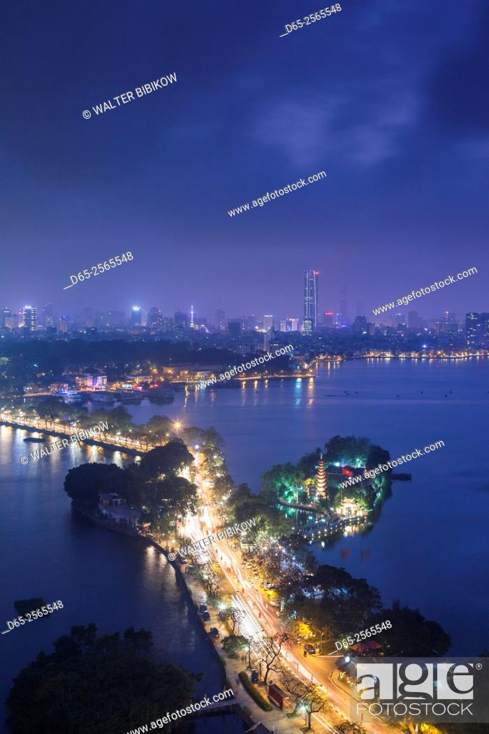 Stock Photo: Vietnam, Hanoi, elevated city view by Tay Ho, West Lake, dusk.