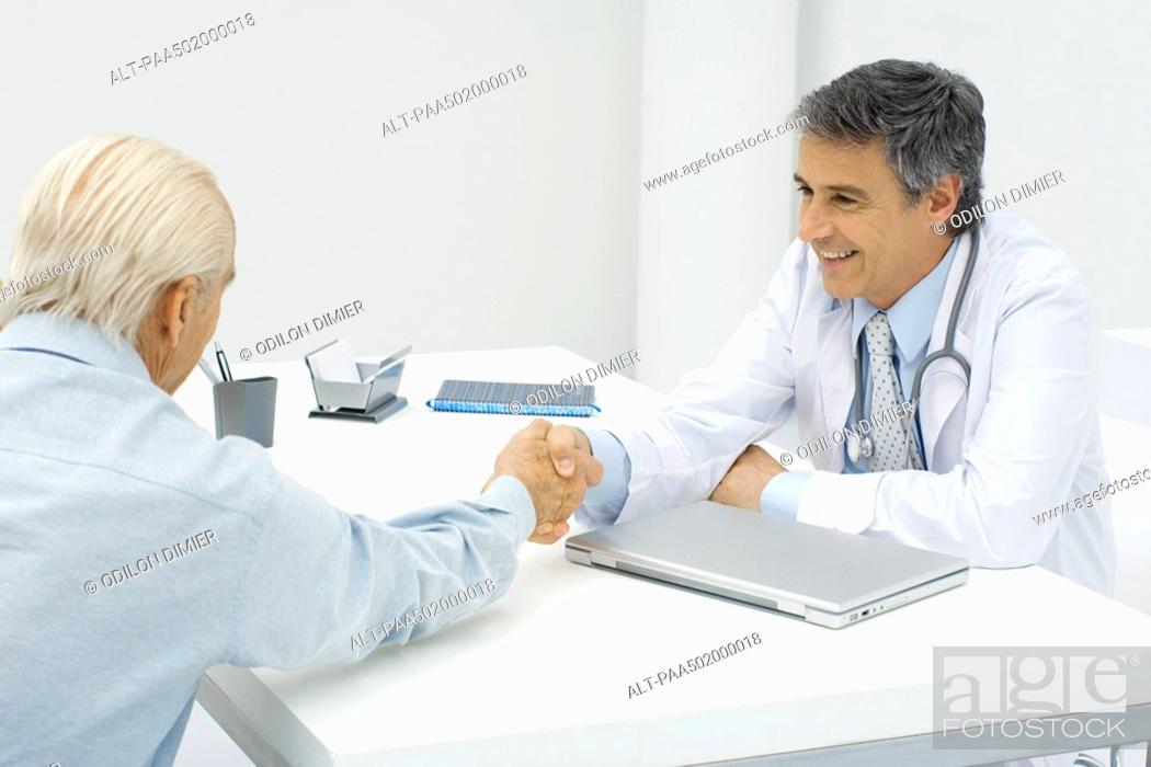 Stock Photo: Doctor shaking hands with patient.