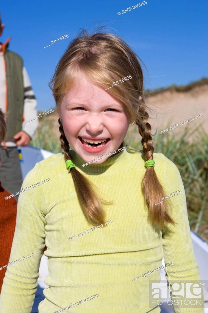 Stock Photo: Portrait of young girl smiling.
