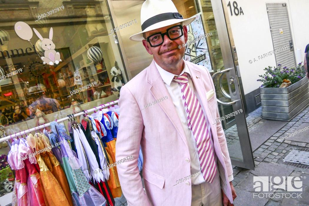 Stock Photo: Gothenburg, Sweden May 31, 2018 Candid street photo of Joakim Dahl. Honorary Consul. Consulate of the Republic of Kazakhstan, dressed in pink.