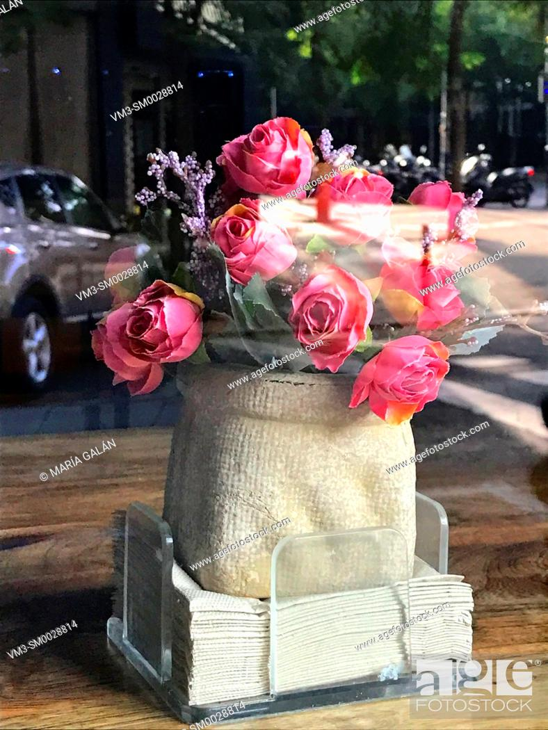 Stock Photo: Pink roses in a shop window.