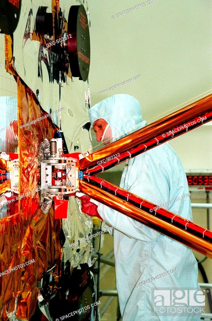 Stock Photo: In the Vertical Processing Facility, a TRW technician checks the attachment of the solar panel array out of sight to the right to the Chandra x-ray Observatory.