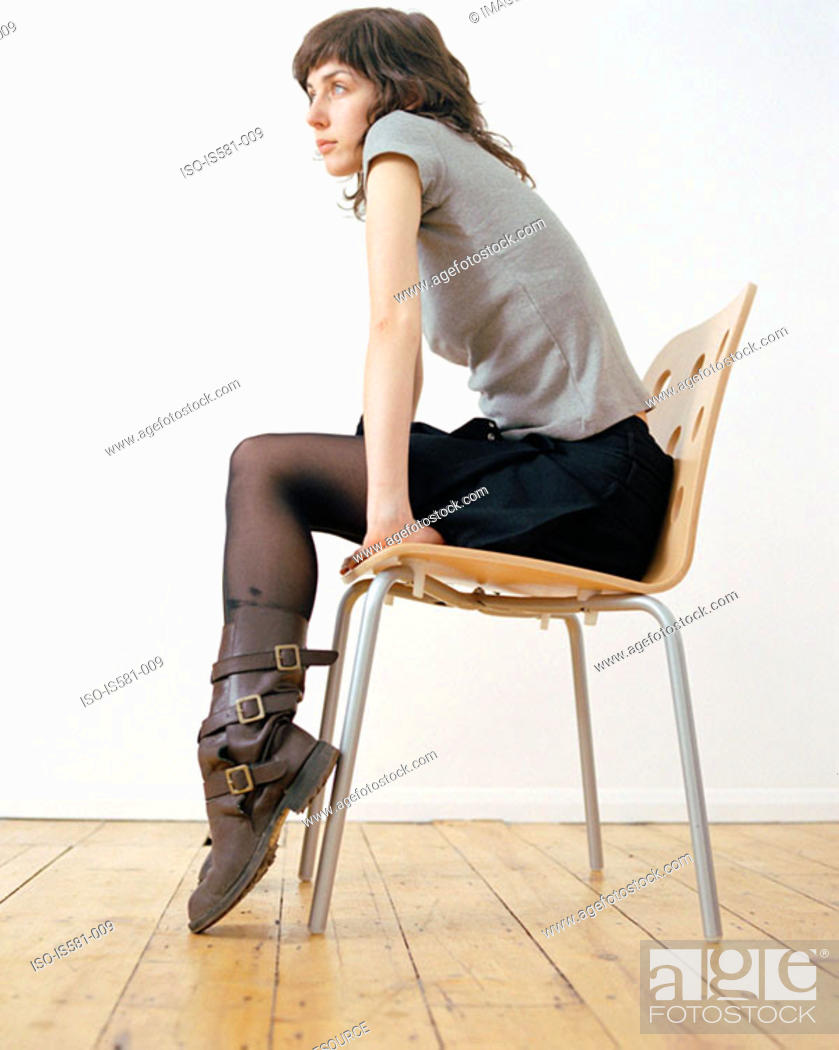 Stock Photo: Woman sitting on chair.