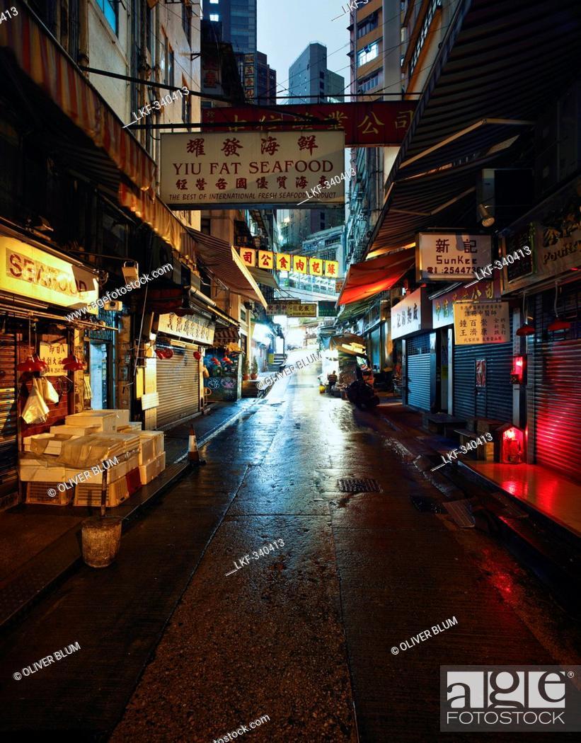 Stock Photo: Fishmonger stalls in Soho District at night, Hong Kong, China.