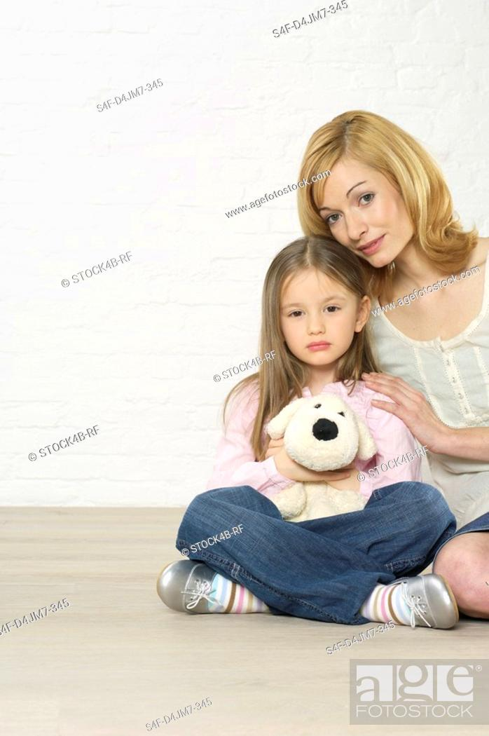 Stock Photo: Mother and daughter sitting on floor.