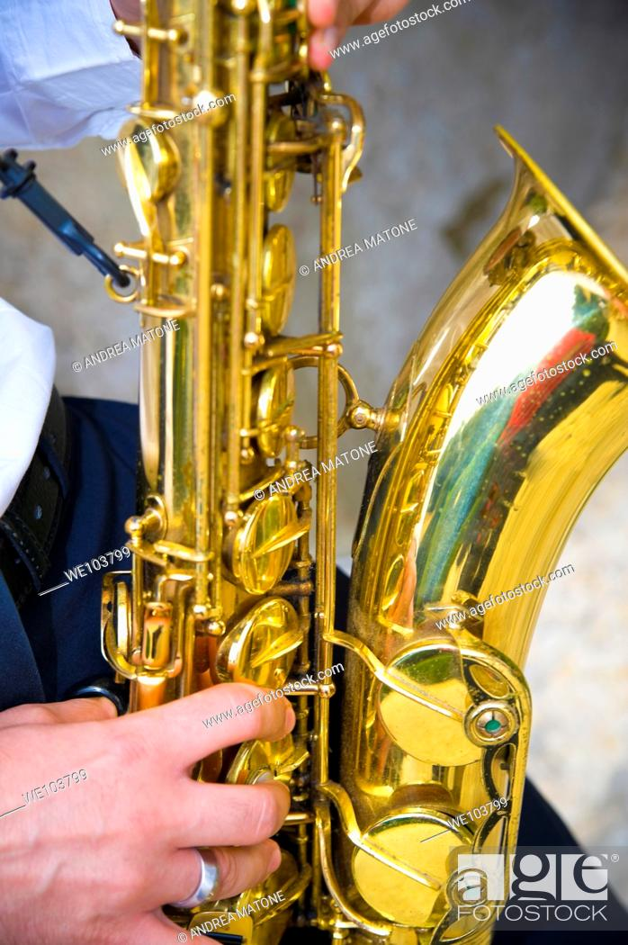 Stock Photo: Saxophone player playing music.
