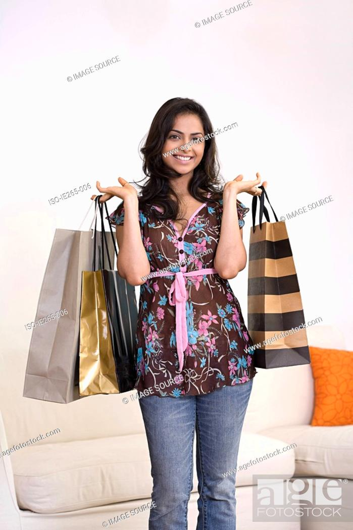 Stock Photo: Portrait of a woman holding shopping bags.