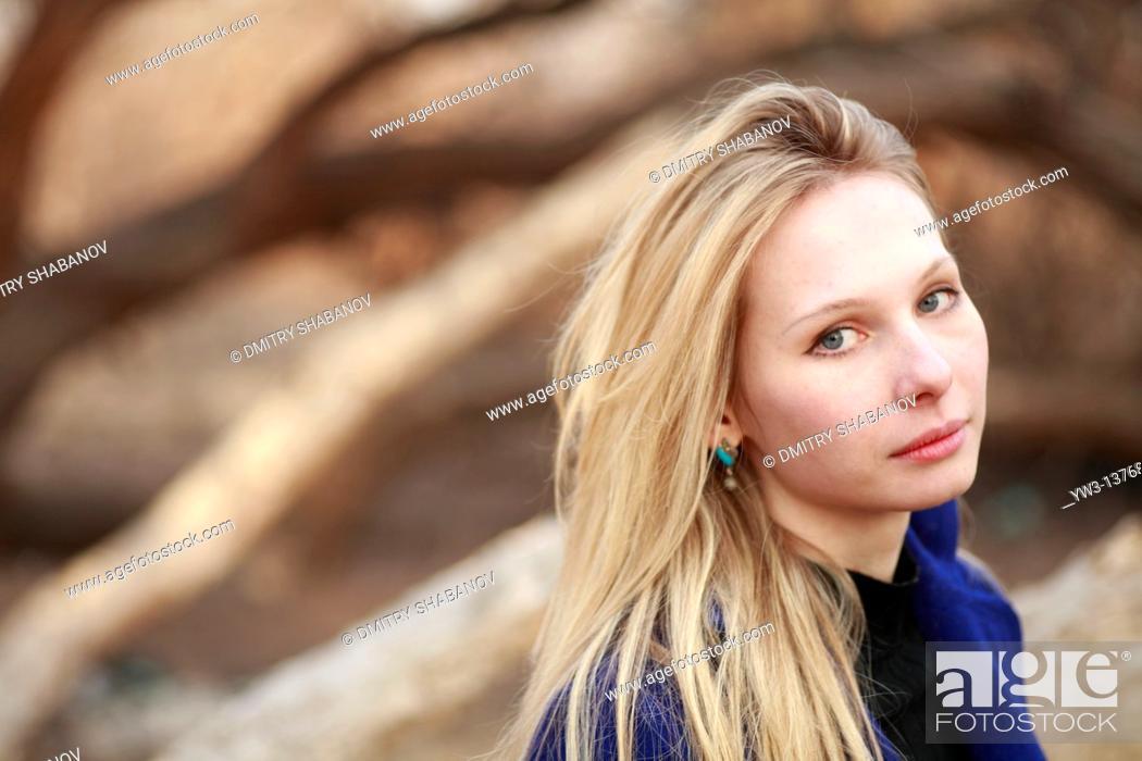 Stock Photo: Portrait of beautiful woman in autumn.