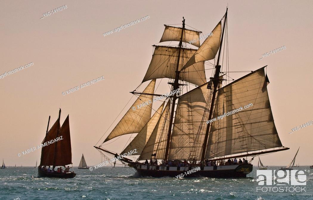 Stock Photo: Old schooner sailing at sunset  Bay of Morbihan, Brittany, France, Europe.