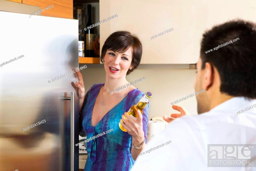 Stock Photo: domestic life: friends sharing a beer.