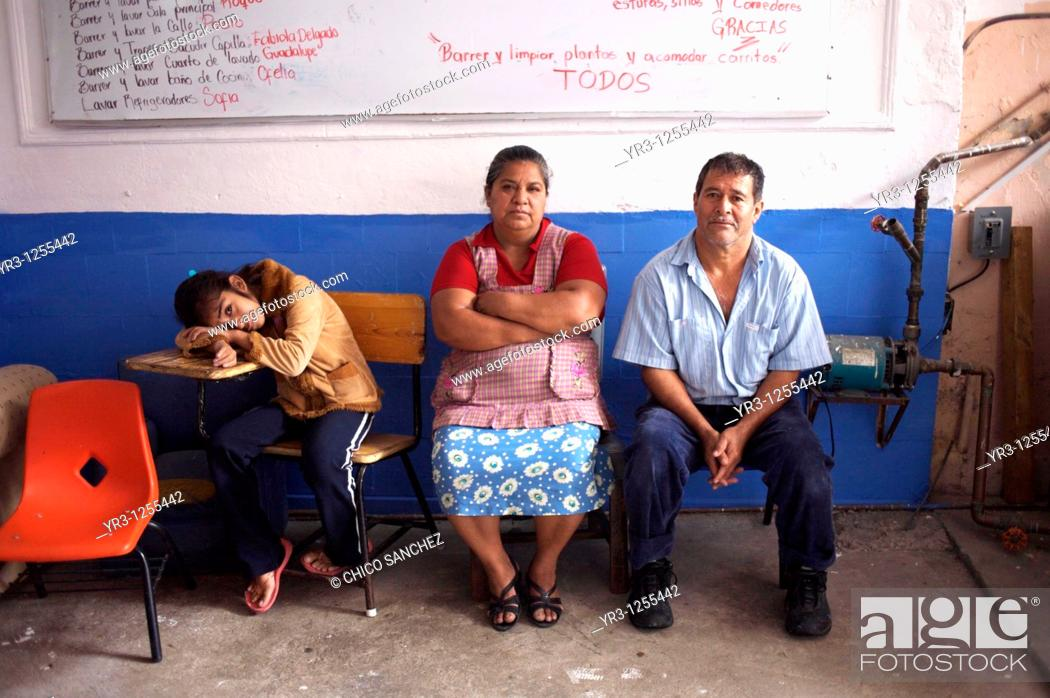 Stock Photo: Cecilia Aguilar Santis, 12, who suffers fallot tetralogy, a congenital heart defect, stands with her parents in a shelter for chronically ill children run by.
