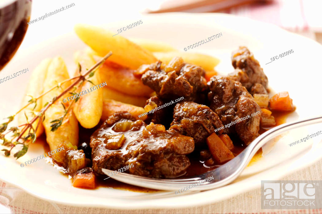 Stock Photo: Venison ragout with potato noodles and thyme.