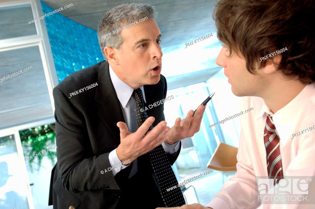 Stock Photo: Businessman discussing with colleague in office.
