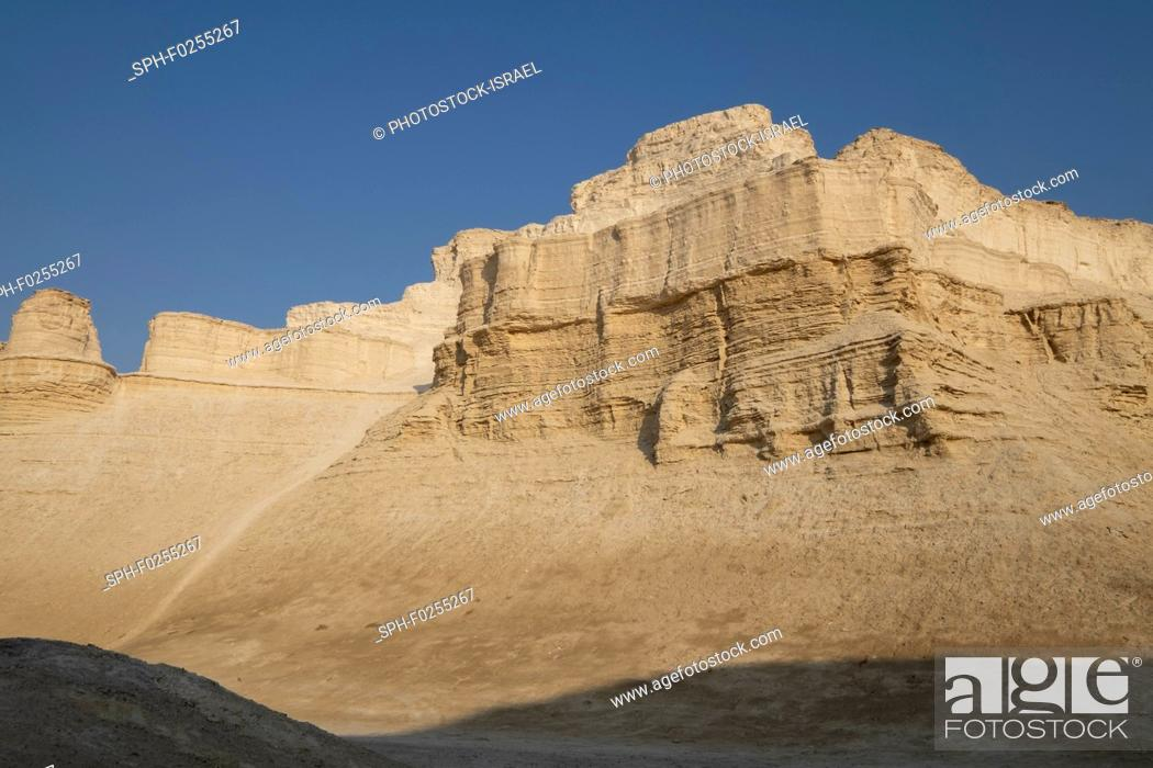 Stock Photo: Marl stone formations. Eroded cliffs made of marl, a calcium carbonate-rich, mudstone formed from sedimentary deposits. Photographed in the Dead Sea region of.