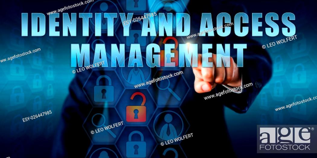 Photo de stock: Business manager is touching IDENTITY AND ACCESS MANAGEMENT on an interactive visual screen. Information technology security concept for management of access.