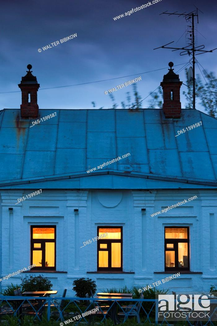 Stock Photo: Russia, Vladimir Oblast, Golden Ring, Suzdal, lit restaurant windows, dusk.