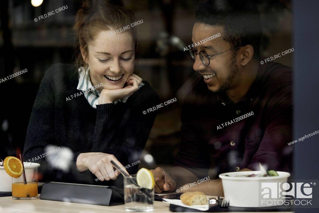 Stock Photo: Couple sitting in restaurant.