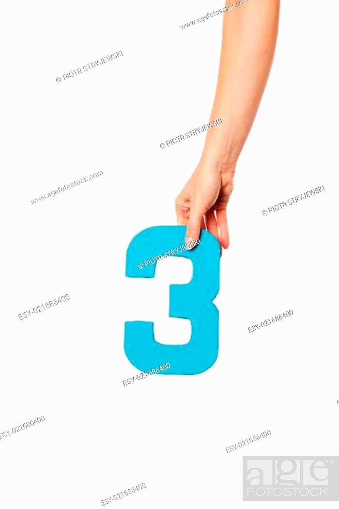 Stock Photo: hand holding up the number three from the top.
