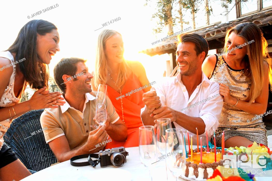 Stock Photo: Friends enjoying birthday party.