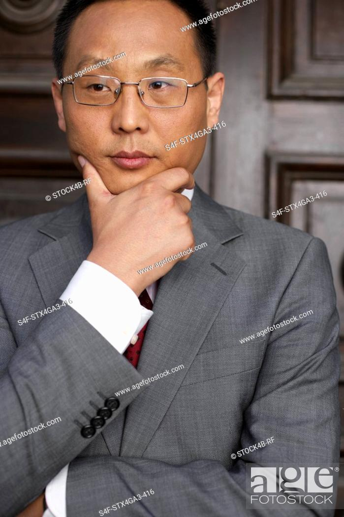 Stock Photo: Thoughtful businessman.