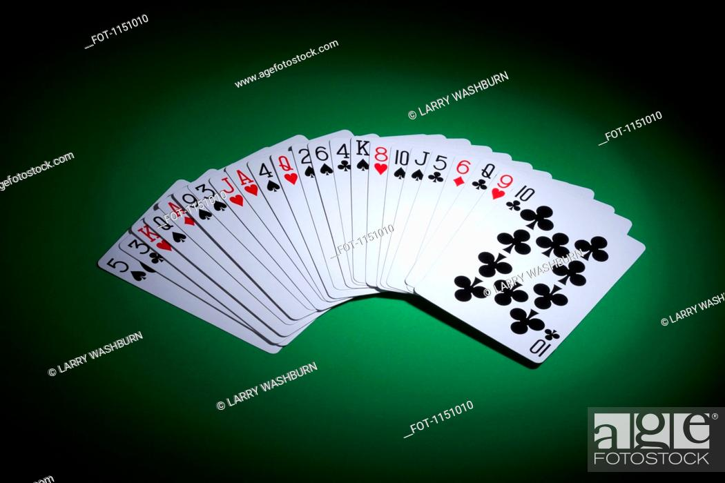 Stock Photo: Cards fanned out on a gambling table.