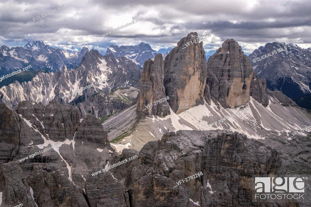 Stock Photo: Aerial view of the Three Peaks of Lavaredo on a cloudy day. Dolomites. Cadore. Veneto. Italy. Europe.