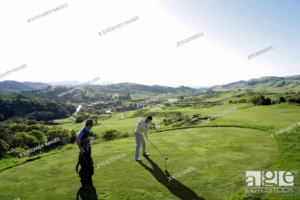 Stock Photo: View of young men playing golf.