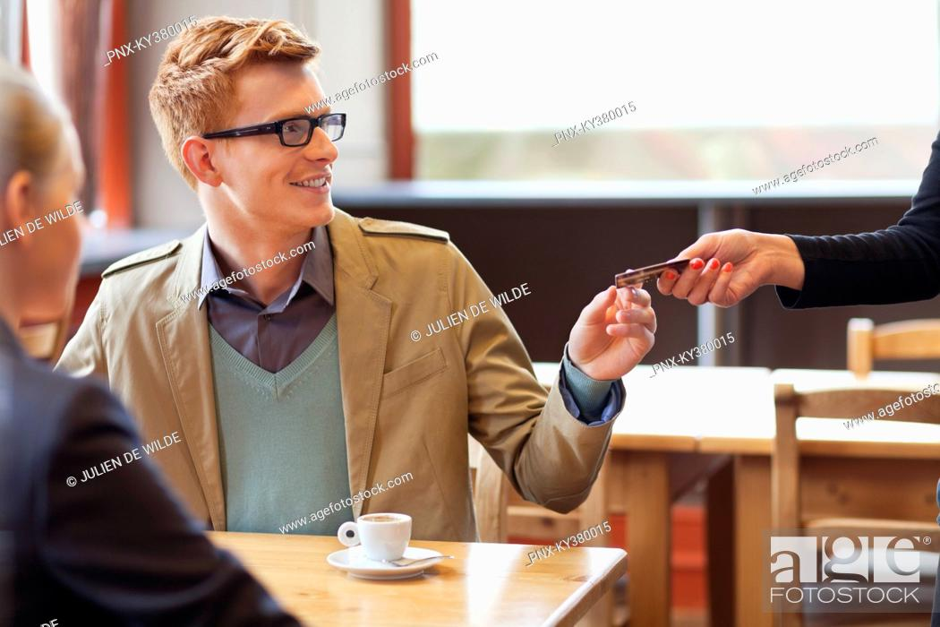 Stock Photo: Man paying bill by credit card in a restaurant.