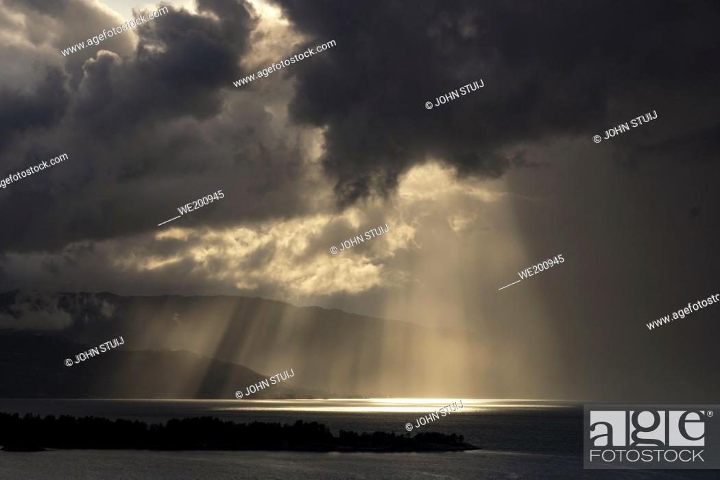 Stock Photo: Turbulent sky above the Hardangerfjord as seen from the small village Herand in the Norwegian municipality Jondal.