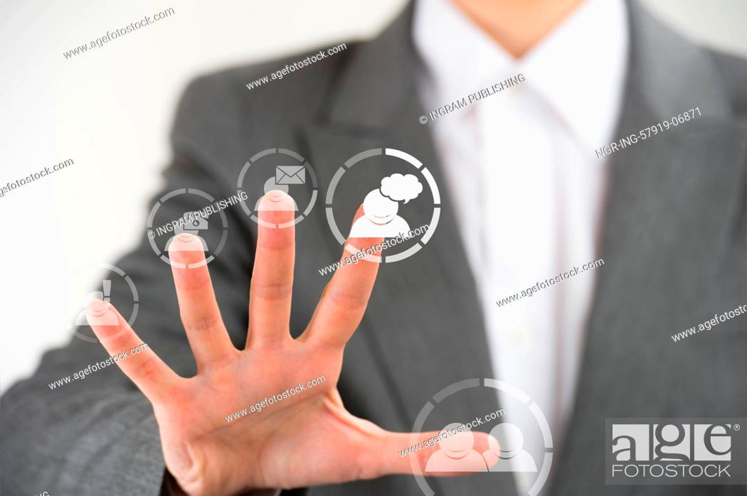 Stock Photo: Business woman pointing her fingers on virtual web interface icons.