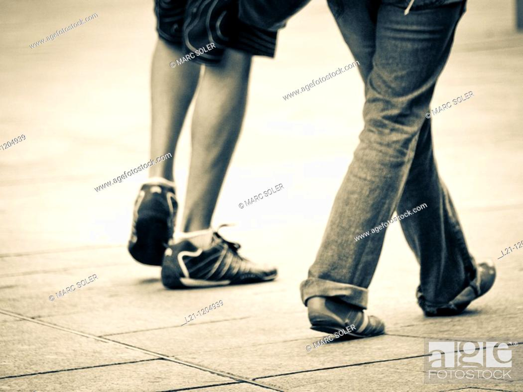 Stock Photo: Couple walking down the street.