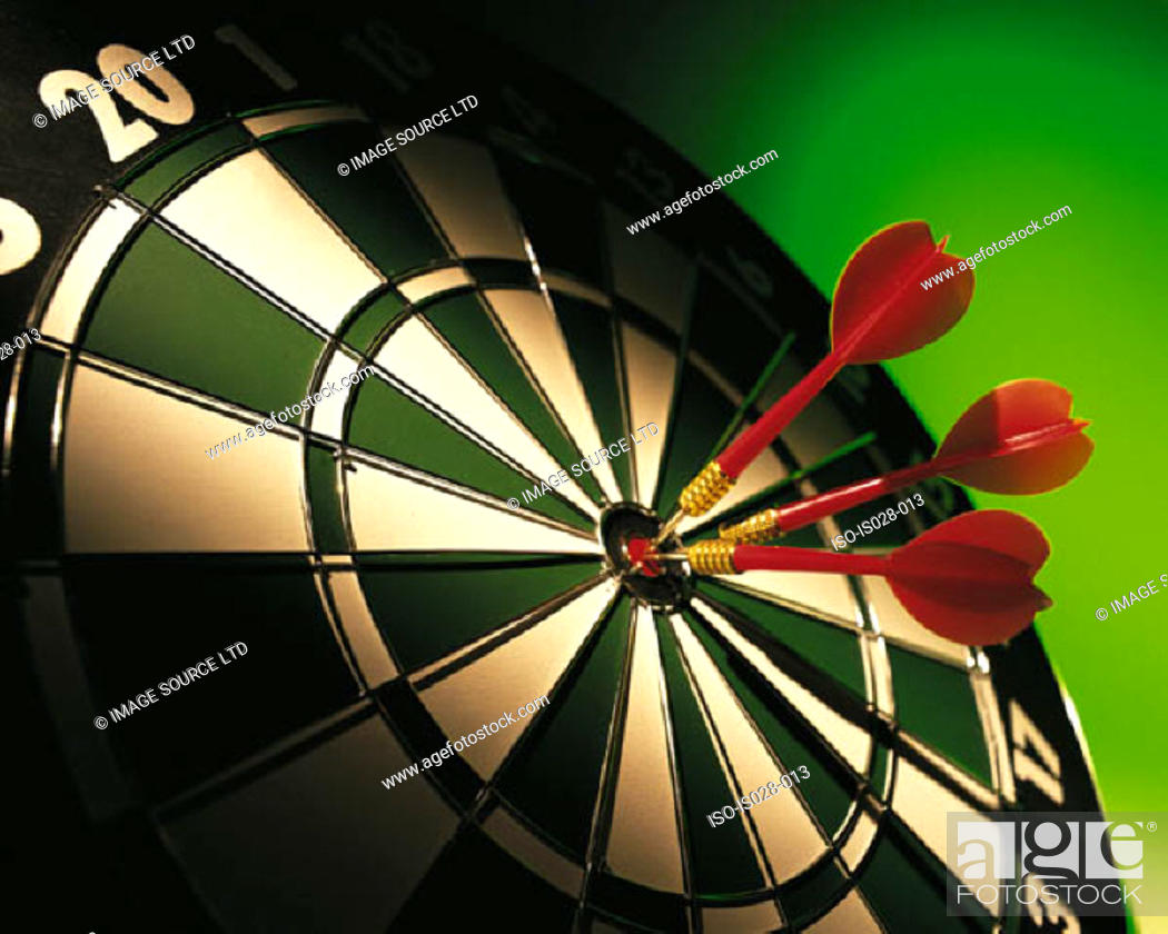 Stock Photo: Dartboard and darts.